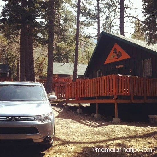 Mitsubishi Outlander in front of cabin