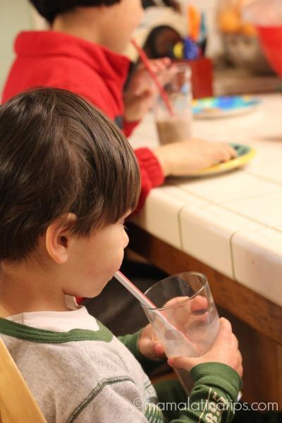 kid drinking chocolate milk by mamalatinatips.com