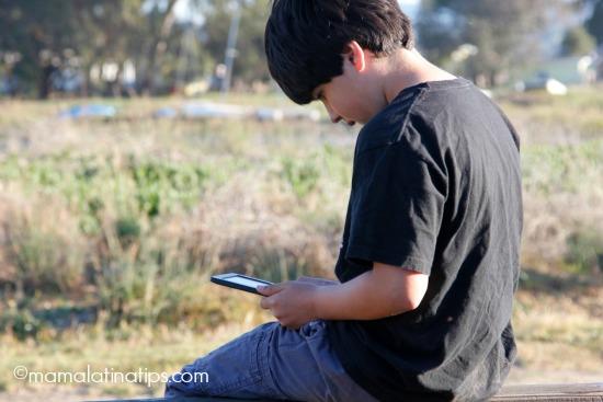 Kid reading on a kindle