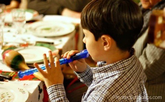 kid playing a blue flute