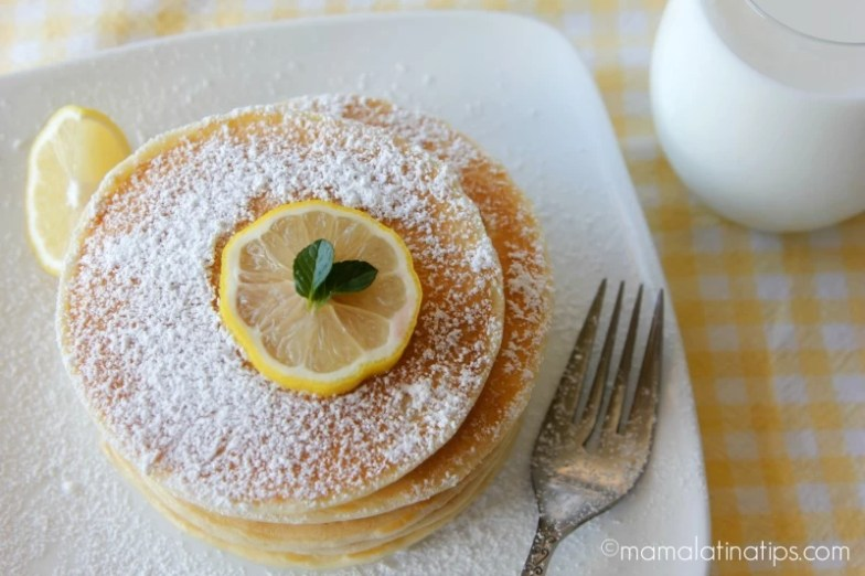 stack of 5 lemon pancakes with a glass or milk