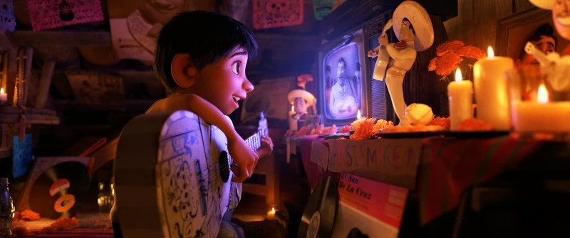 Scene of Coco, Miguel and his guitar watching his idol Ernesto de la Cruz - mamalatinatips.com