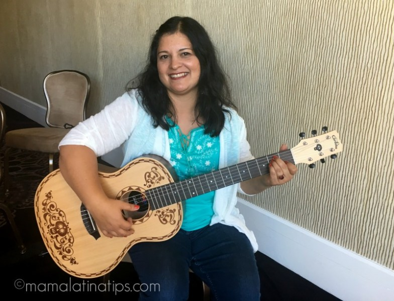 Silvia playing with a replica of Coco's guitar