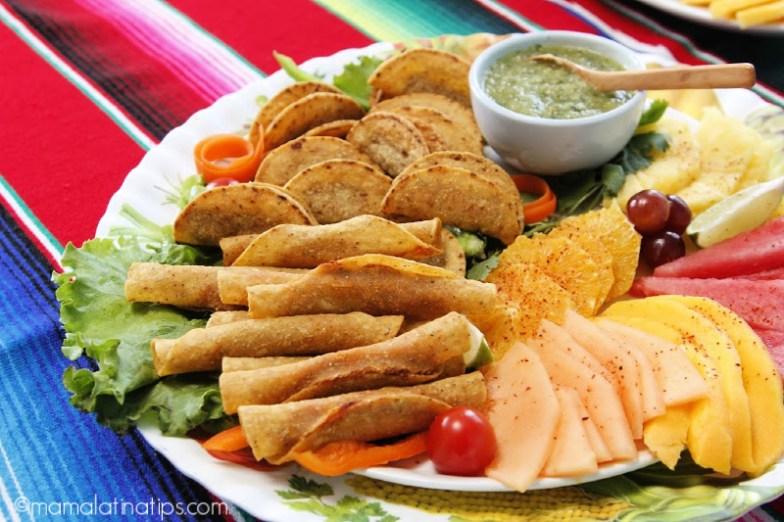 Mexican platter with taquitos dorados, fruit and salsa