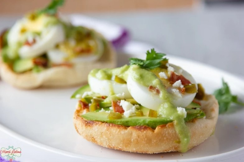 Two Hard-Boiled Egg Avocado English Muffins on a white plate