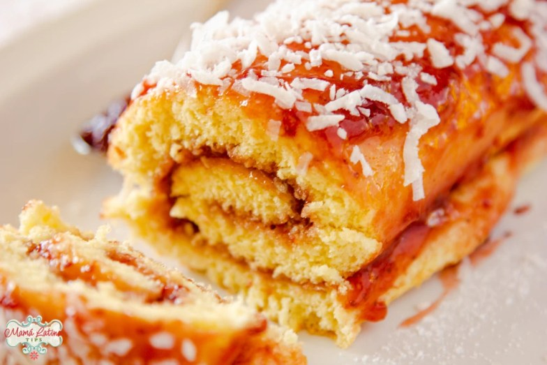 Mexican Jelly roll, Niño Envuelto, cake sliced on a white plate