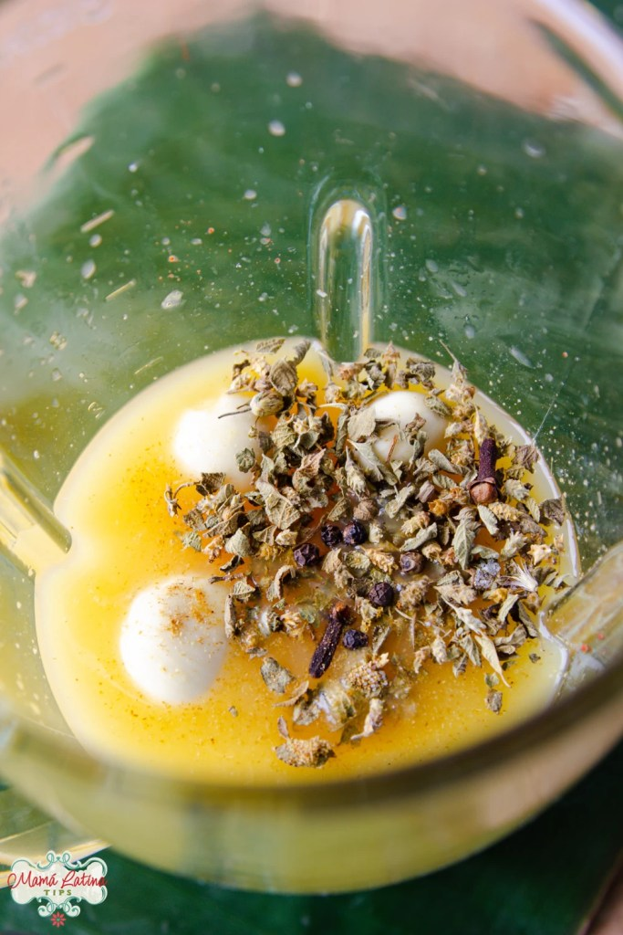 orange juice, garlic and spices in a blender