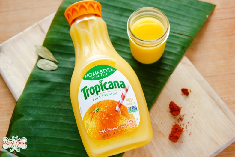 tropicana orange juice bottle on top of a banana leaf
