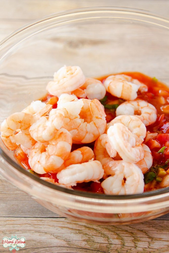 cooked shrimp on top of a tomato sauce.