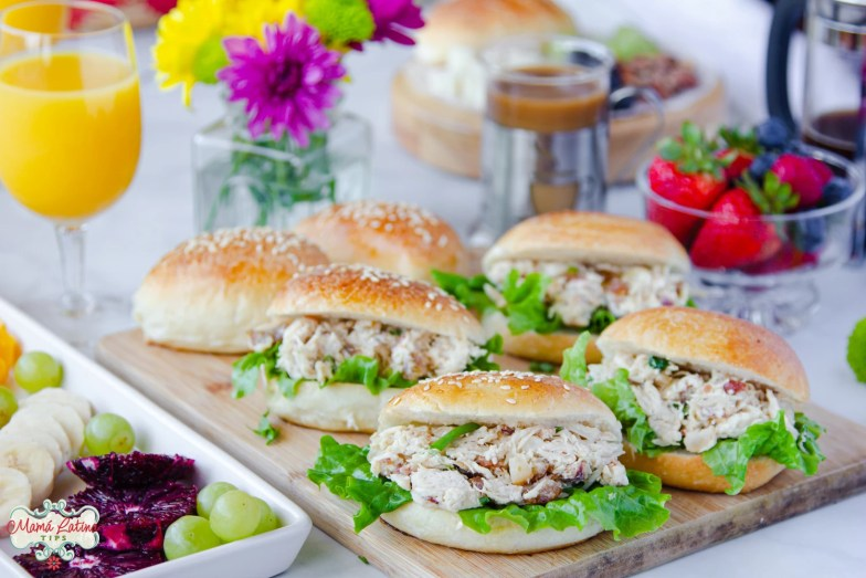 Macadamia Bacon Chicken Salad with Date Sandwiches on a brunch table with fruit, flowers and coffee
