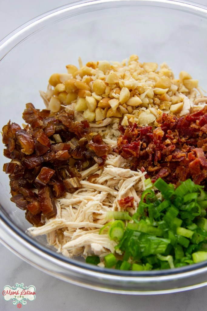 Chicken, dates, macadamia nuts, bacon and green onions chopped in a bowl