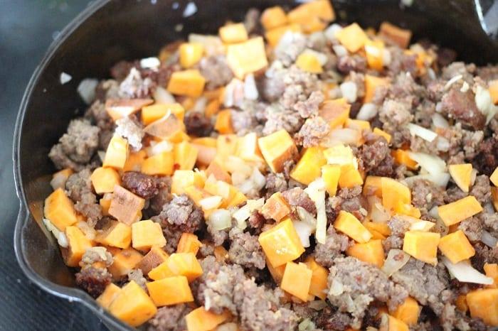 Sweet Potato and Sausage Hash on the stove top