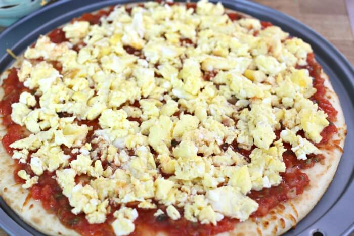 fluffy scrambled eggs and salsa on pizza