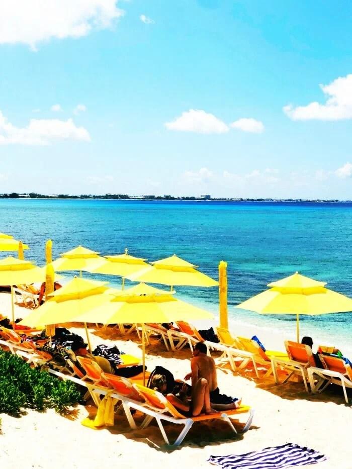 YELLOW UMBRELLAS ON THE BEACH OF GRAND CAYMAN ISLAND