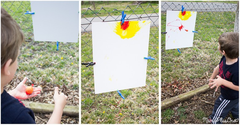 Kids bored this summer? Let them be kids with this awesome messy play activity! This splatter painting uses water balloons, medicine droppers, squirt guns, and more to create a unique piece of abstract art your kids will love creating. Don't worry-- kids and clothes are both washable! #allEssentials