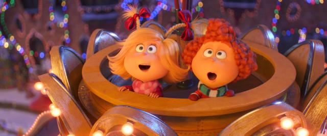 (from left) Cindy-Lou Who (Cameron Seely) and her best friend Groopert (Tristan O'Hare) bask in the beauty of Whoville at Christmas in Dr. Seuss' The Grinch from Illumination.