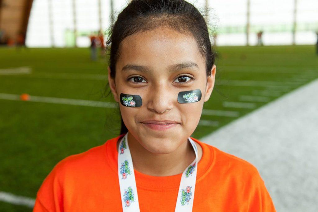 Latino girl in eye black close up