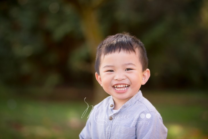 Happy Boy outdoor portrait with a very big smile, Vancouver BC