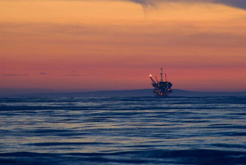 Off shore oil rig by sunset (California). Via photoeverywhere.co.uk