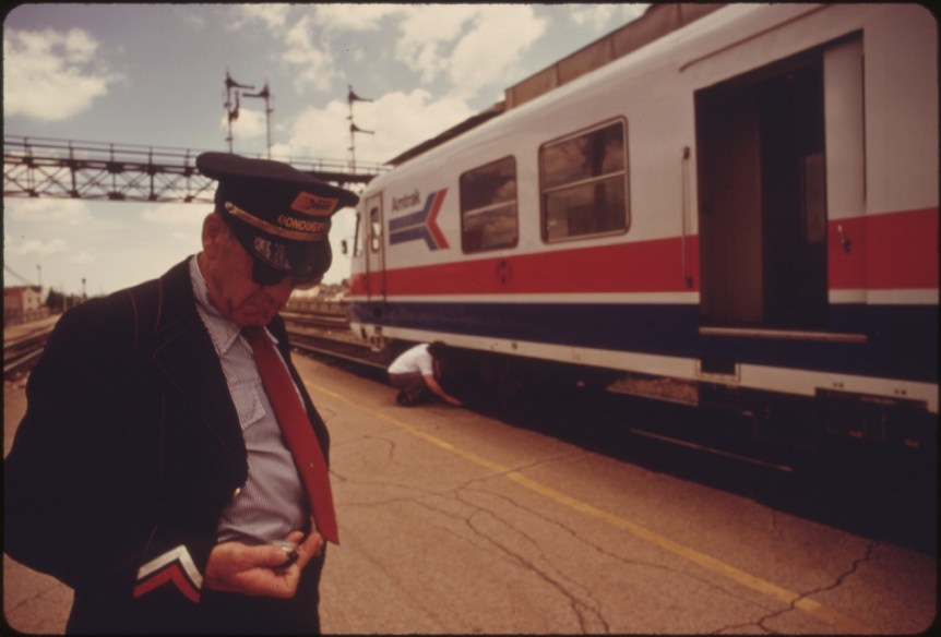 Conductor checks his watch to find out how much time remains at the Bloomington, Illinois, stop on the Turboliner run between St. Louis, Missouri, and Chicago. Photo by Charles O'Rear for the U.S. Environmental Protection Agency (1970). (NARA record: 3403717)