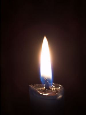 Flame in darkness, licensed through 123rtf.com. Do not reuse without permission.