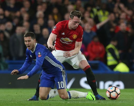 LONDON, ENGLAND - MARCH 13: Phil Jones of Manchester United in action with Eden Hazard of Chelsea during the Emirates FA Cup Quarter-Final match between Chelsea and Manchester United at Stamford Bridge on March 13, 2017 in London, England. (Photo by Matthew Peters/Man Utd via Getty Images)
