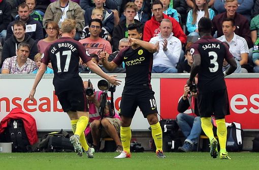 SWANSEA, WALES - SEPTEMBER 24: Sergio Aguero of Manchester City (C) celebrates his opening goal with team mates Kevin De Bruyne (L) and Bacary Sagna during the Premier League match between Swansea City and Manchester City at The Liberty Stadium on September 24, 2016 in Swansea, Wales. (Photo by Athena Pictures/Getty Images)