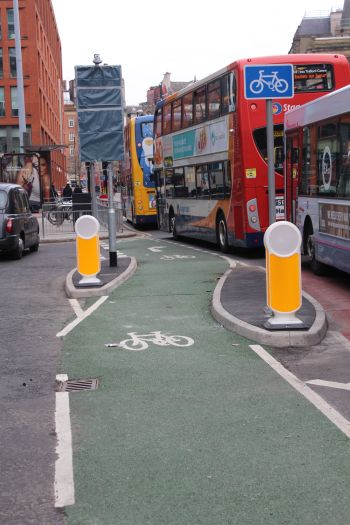 Portland Street - cycle lane - cross bus lane and with added taxis