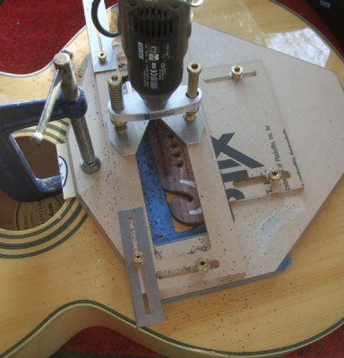 Using Stewmac saddle routing jig on Epiphone EJ 200 left hand conversion