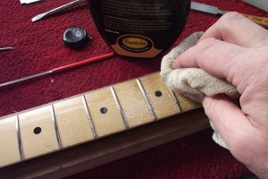 Using Farecla to buff the frets and fretboard