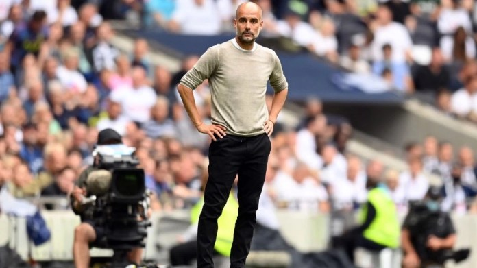 WATCHING BRIEF: Pep Guardiola looks on