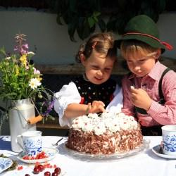 Children eating Black Forest Gateau