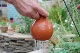 Thumb Pot Waterer, from Internet Gardener