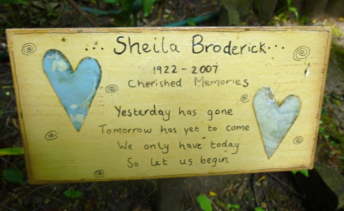 One of the many memorial plaques, benches and ornaments