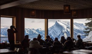 Friends grab a bite to eat at the Cliff House Bistro located at the top of Mount Norquay.