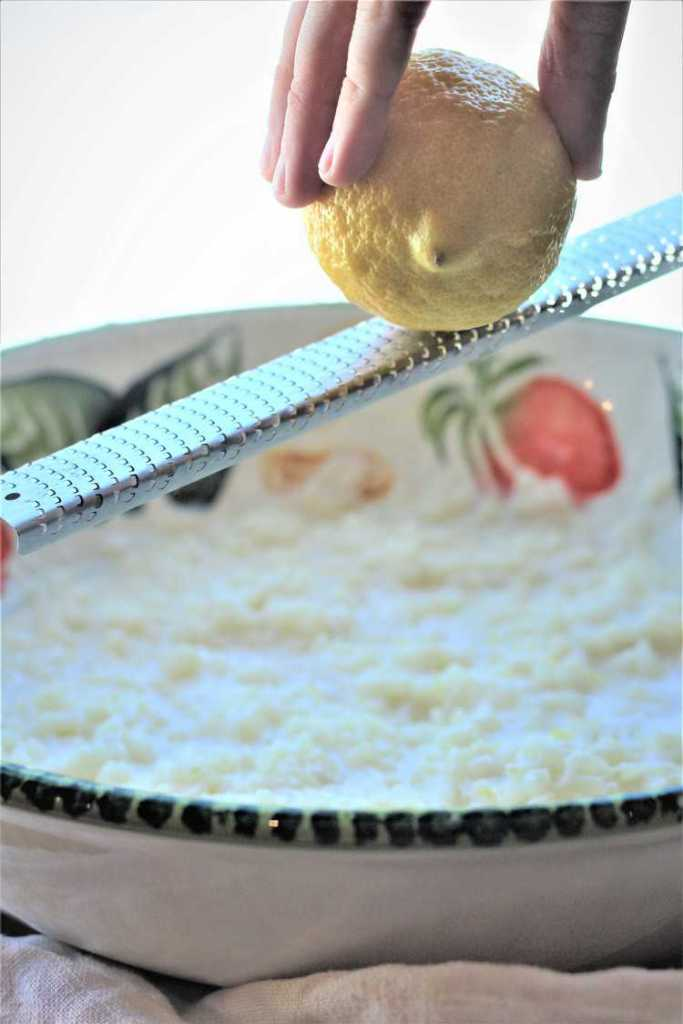 adding lemon zest to rice for Easy No Crust Easter Pastiera