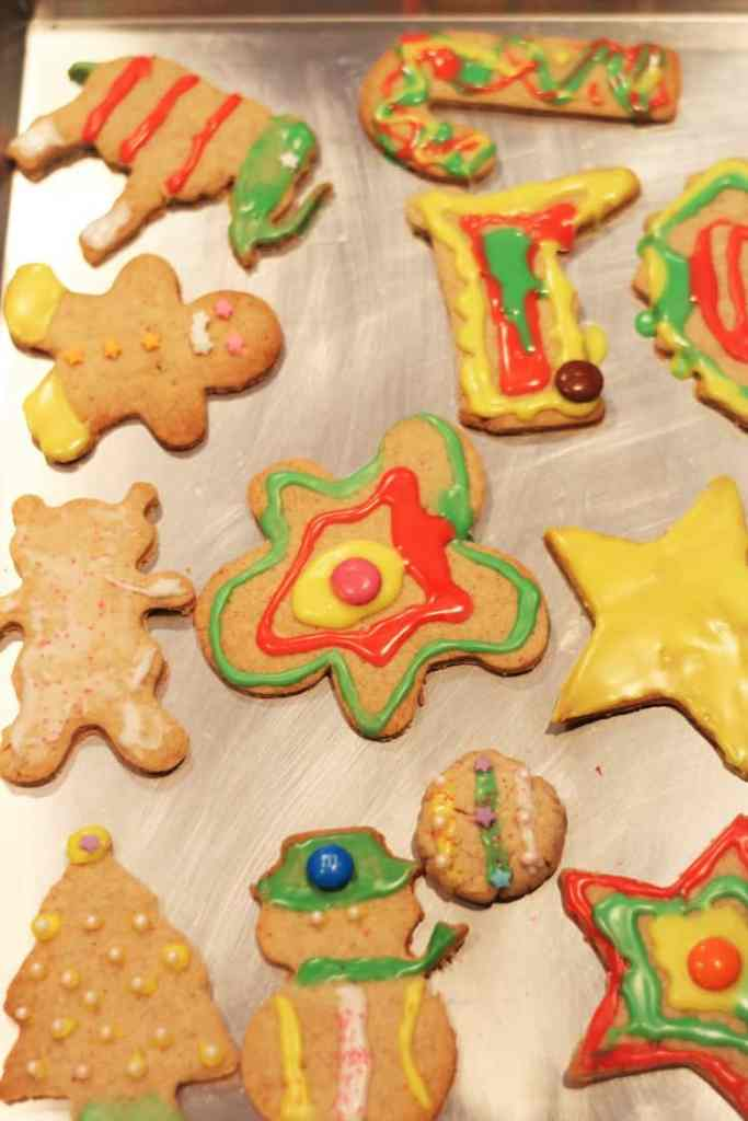 baking sheet with decorated Christmas cookies