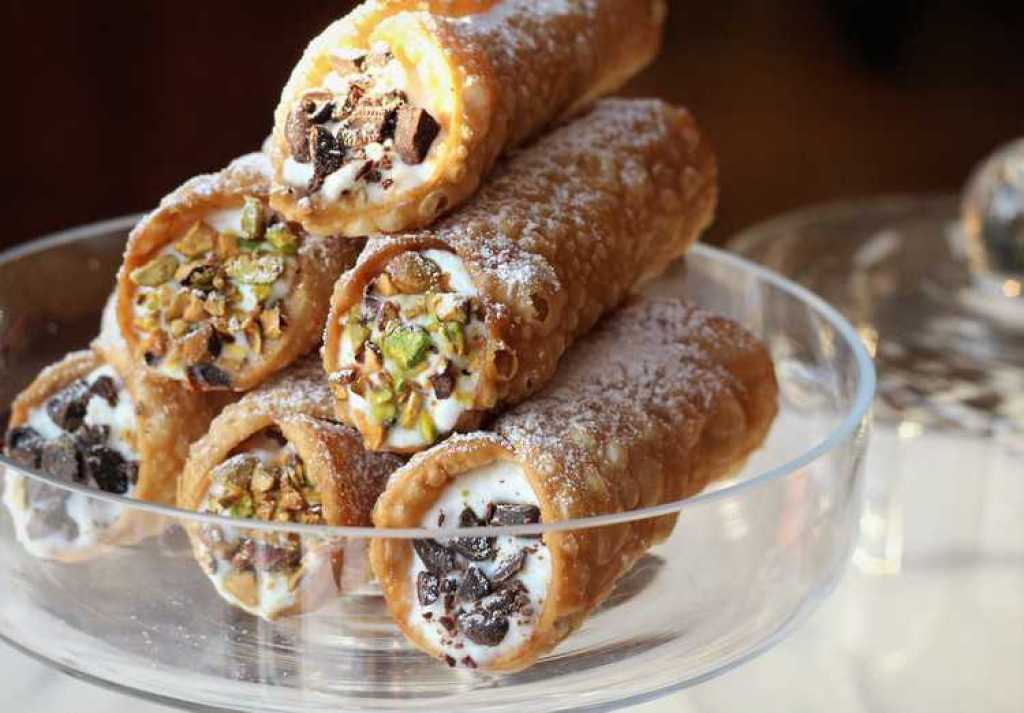 Sicilian Cannoli with Ricotta piled on a serving plate