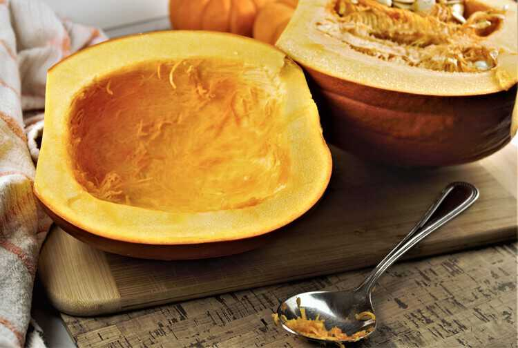 halved pumpkin with insides scooped out