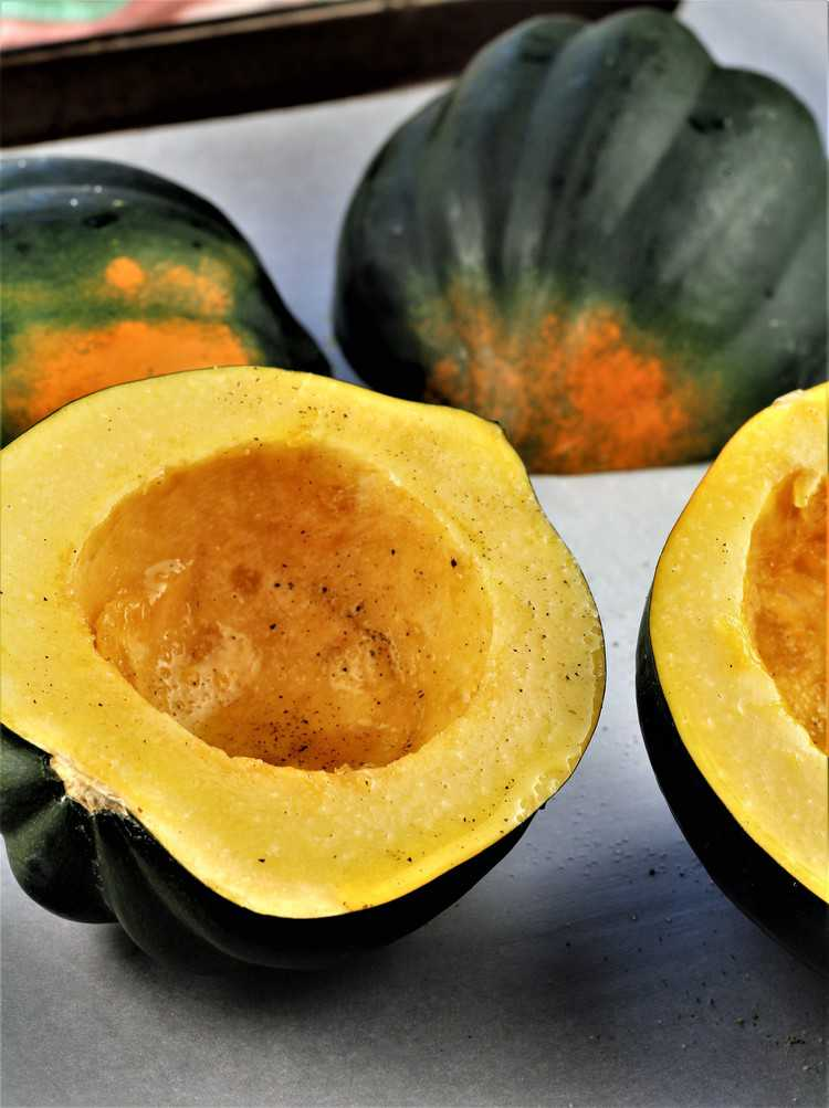 halved acorn squash drizzled with olive oil and salt and pepper