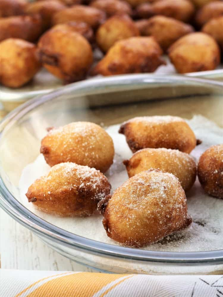 coating fritters in sugar