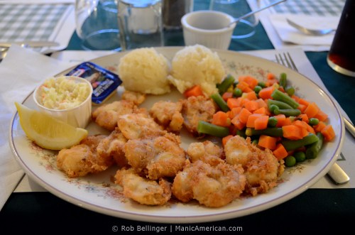 A plate of fried cod tongues with boiled vegetables and cole slaw. Margaree, Newfoundland.