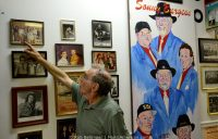 Henry Harrison points to a photo on the wall of the International Rock-a-billy Hall of Fame