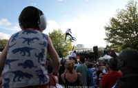 A child watches BMX stunts.