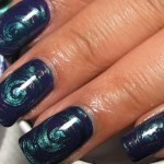 Try This Beautifully Eye Catching Purple Metallic Teal Water Marble Nail Art
