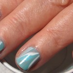 Be Ready For Whatever Life Throws At You With This Turquoise White Grey Water Marble Nail Art