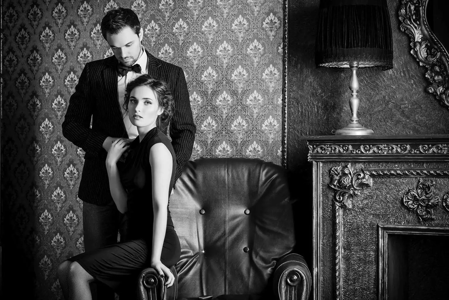 Beautiful man and woman in elegant evening clothes in classic vintage apartments. Glamour, fashion.