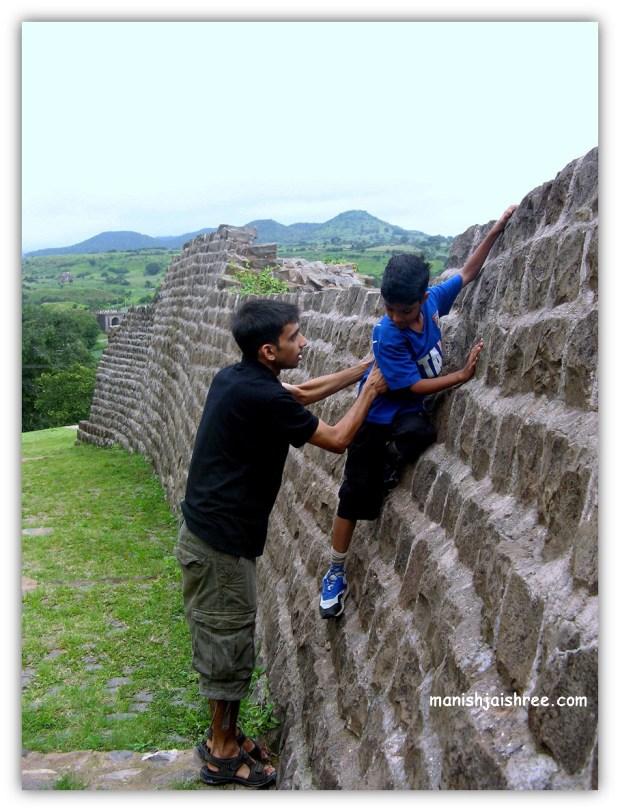 climbing up the walls of Mandu