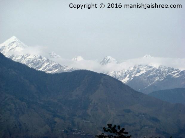 Clouds moving the veil over Panchachuli peaks, Munsiyari