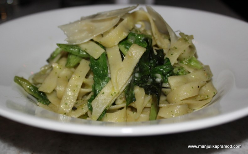 Home-made fettuccini with fresh basil, spring onion, broccoli, rocket and feta cheese